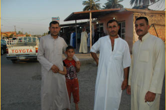 The man in the center is the person who is the nephew of my friend Mohammad.  I met this man 11-years ago when I first visited Dholoyia. His name is Qasi.