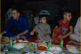 The little boy in the center sits with the adults and learns.  His was father was killed a some time back by ISIS.  Raising him becomes a family affair.  He is a precious child.