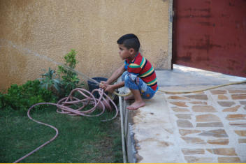 Abud playing with water hose