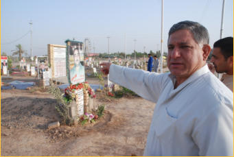 General Abdullah at the cemetery where the warriors were buried.  Most were buried in gardens at home and later transferred to the cemetery after the battle ended in January 2015