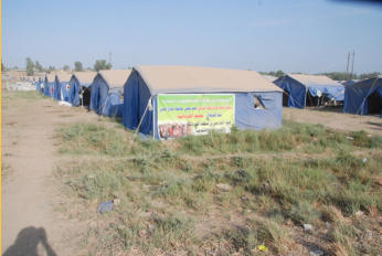 "The first photo I took of ""tent city"" for the internally displaced people who are refugees in their own town."